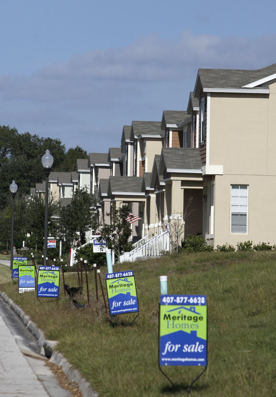 This Dec. 20, 2011 photo, shows a row of new homes for sale, in Winter Garden, Fla. Fixed mortgage rates rose slightly this week off their record lows. The year ends much like it began, with few people able to take advantage of the best rates in history. (AP Photo/John Raoux)