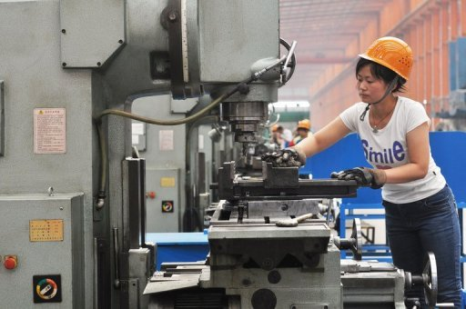 <p>A worker is pictured as she operates a machine at a factory in Binzhou, northeast China's Shandong province, on June 5. China's manufacturing activity hit a seven-month low in June as shrinking exports and weak domestic demand shook the world's second largest economy, according to British bank HSBC.</p>