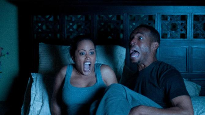 """This film image released by Open Road Films shows Essence Atkins, left, and Marlon Wayans in a scene from """"A Haunted House."""" (AP Photo/Open Road Films, Will McGarry)"""