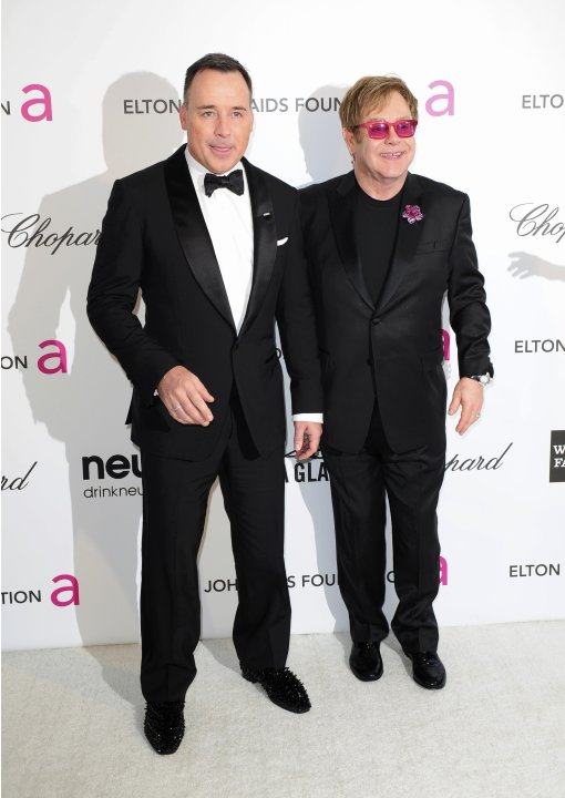 Musician John and his partner Furnish arrive at the 2013 Elton John AIDS Foundation Oscar Party in West Hollywood, California