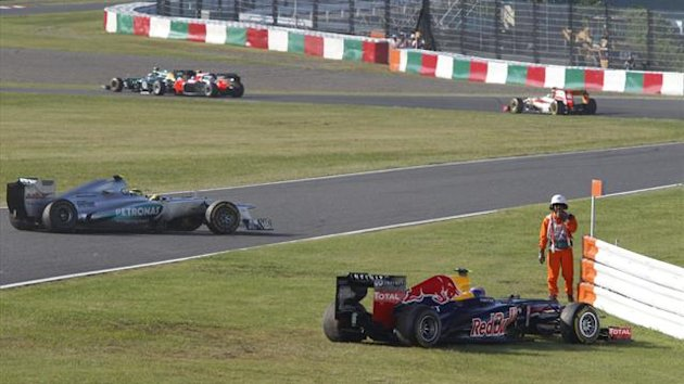 Mark Webber comes to rest on the grass after a first-lap collision at the Japanese GP