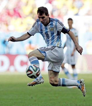 Lionel Messi leaps the catch a pass during the World Cup quarterfinal soccer. (AP)