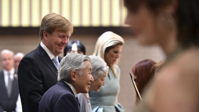 Japan's Emperor Akihito and Empress Michiko greet concert performers after their performance as they are escorted by King Willem-Alexander and Queen Maxima of Netherlands at a hotel in Tokyo