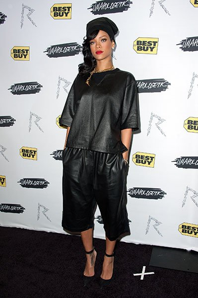 An exhausted, semi-apologetic Rihanna touches down in NYC and attends her &quot;Unapologetic&quot; record release party - An unapologetically baggy leather top and three-quarter pants clash with an unapologetic