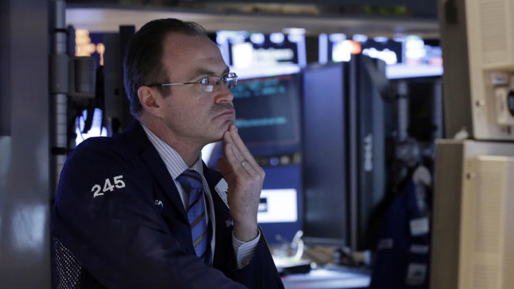 Specialist Derek Orth works at his post on the floor of the New York Stock Exchange Tuesday, March 19, 2013. A surprisingly strong increase in new home construction is sending stocks higher in early trading on Wall Street. (AP Photo/Richard Drew)