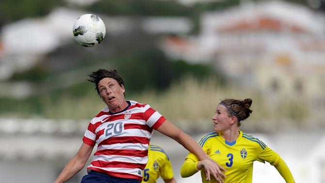 Abby Wambach, left, of the US, jumps for the ball with Sweden's Emma Berglund during their Algarve Cup  women's soccer match Monday, March 11 2013, in Lagos, southern Portugal. (AP Photo/Armando Franca)