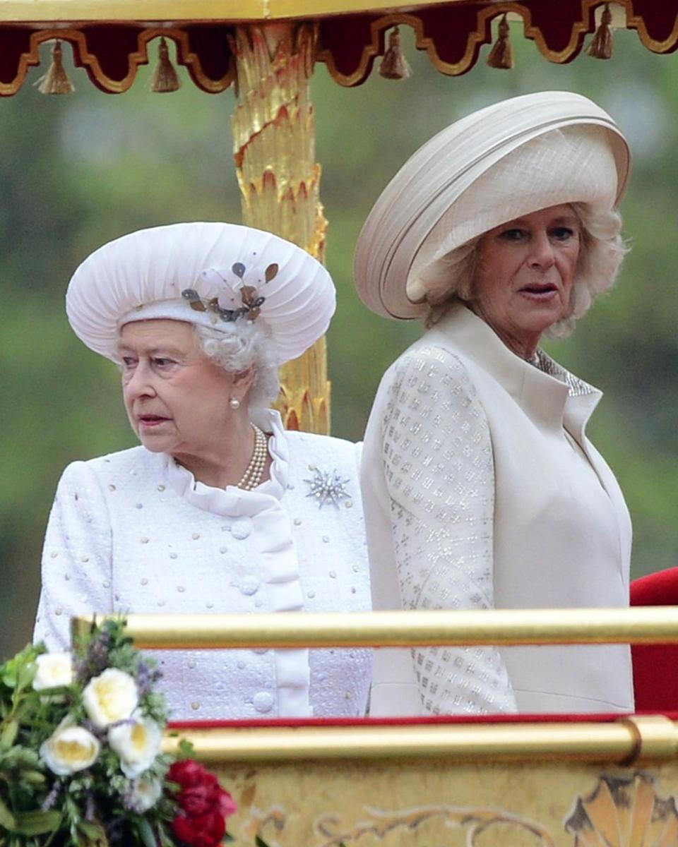 Britain's Queen Elizabeth II, left, and Camilla, Duchess of Cornwall, stand together aboard the royal barge 'Spirit of Chartwell' during the Thames Diamond Jubilee Pageant on the River Thames in London, Sunday June 3, 2012. (AP Photo/Adrian Dennis)