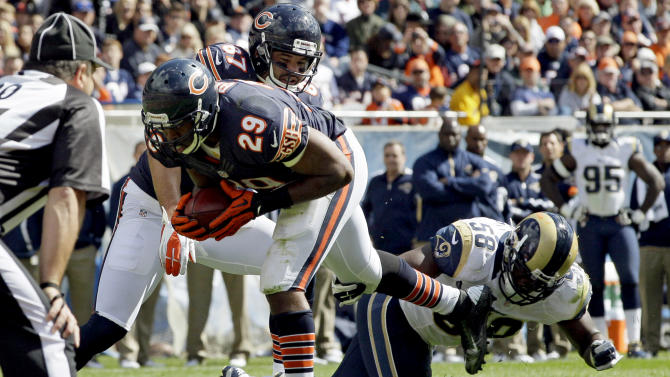 Chicago Bears running back Michael Bush (29) rushes for a touchdown past St. Louis Rams linebacker Jo-Lonn Dunbar (58) in the first half of an NFL football game in Chicago, Sunday, Sept. 23, 2012. (AP Photo/Nam Y. Huh)