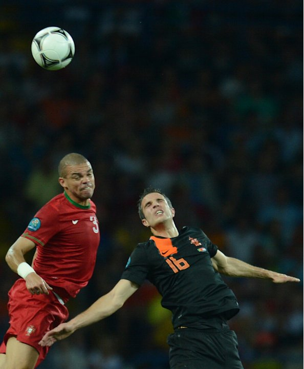 Dutch Forward Robin Van Persie (R) Vies AFP/Getty Images