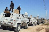 Egyptian security forces stand by their armoured vehicles in the northern Sinai Peninsula on August 8. Egyptian security forces have killed six gunmen in a raid on a village of North Sinai, as the military pressed a campaign against Islamists in the lawless peninsula neighbouring Gaza and Israel
