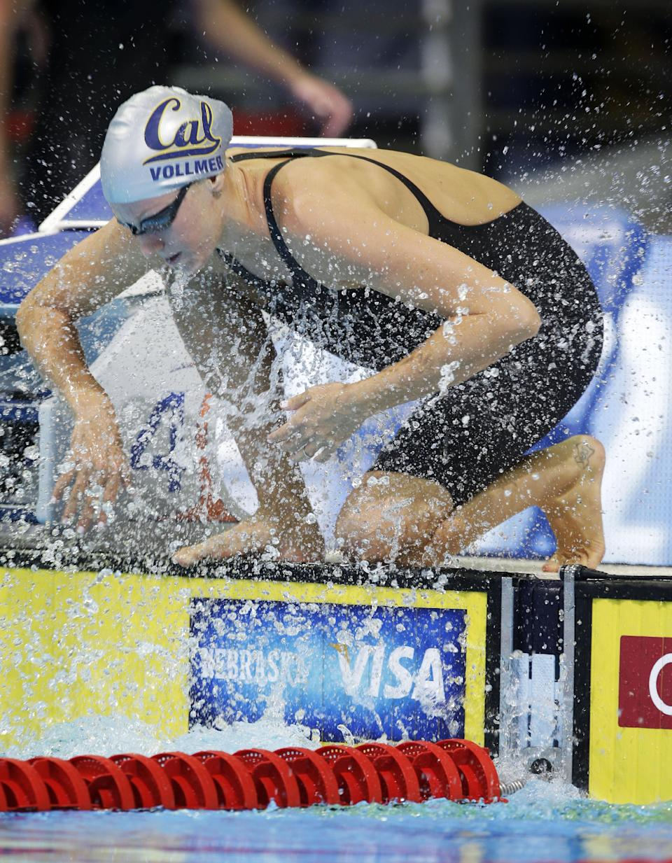 Dana Vollmer prepares to swim in the women's 200-meter freestyle preliminaries at the U.S. Olympic swimming trials on Wednesday, June 27, 2012, in Omaha, Neb. (AP Photo/Mark Humphrey)