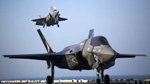 Two U.S. Marine F-35B Lightning II Joint Strike Fighters complete vertical landings aboard the USS Wasp during operational testing
