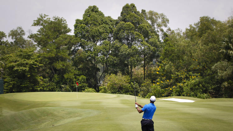 Tiger Woods of the United States watches the flight of his ball on hole 5 during round one of CIMB Classic golf tournament at the Mines Resort and Golf Club in Kuala Lumpur, Malaysia, Thursday, Oct. 25, 2012.  (AP Photo/Vincent Thian)