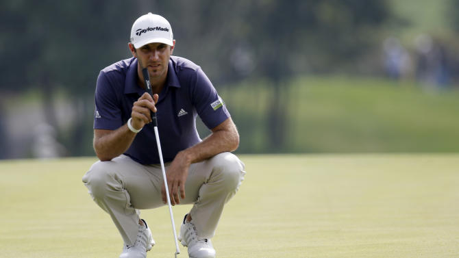 Dustin Johnson of the United States prepares to putt on the 1st green during the second round of the HSBC Champions golf tournament at the Sheshan International Golf Club in Shanghai, China, Friday, Nov. 1, 2013. (AP Photo/Eugene Hoshiko)
