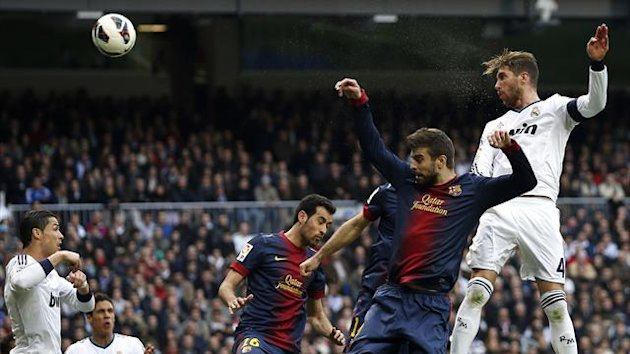 Real Madrid's Sergio Ramos heads the winning goal against Barcelona (Reuters)