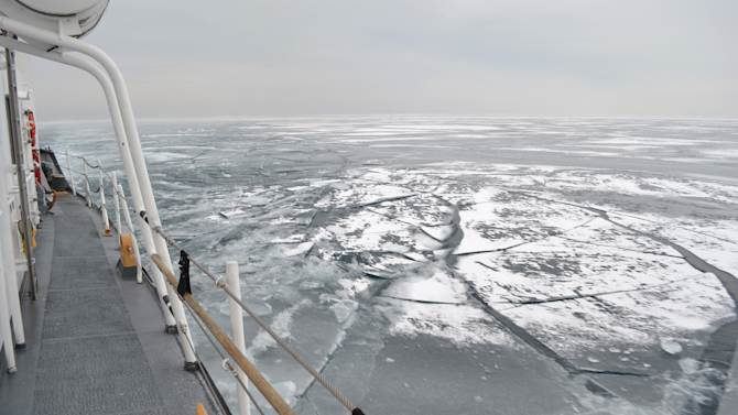 FILE - In this Feb. 12, 2014 file photo the Coast Guard Cutter Biscayne Bay, a 140-foot ice-breaking tug, sails through ice covered waters toward the shores off Indiana. U.S. Steel said Monday, April 7, 2014 that its largest mill in Gary, Ind., is on limited production after a shortage of vital iron ore due to the ice covering Lake Superior had temporarily shut down its furnaces. (Coast Guard photo by Chief Petty Officer Alan Haraf, File)