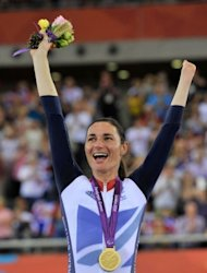 Great Britain's Sarah Storey celebrates with the gold medal after winning the Women's Individual C4-5 500m Cycling Time Trial during the London 2012 Paralympic Games