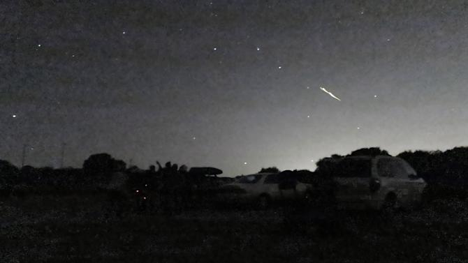 In this photo taken Oct. 17, 2012 and provided by Phil Terzian is a shooting star above the Montebello Open Space Preserve in Palo Alto, Calif. Streaking fireballs lighting up California skies and stunning stargazers are part of a major meteor shower, and the show is just getting started, professional observers said. (AP Photo/Phil Terzian)