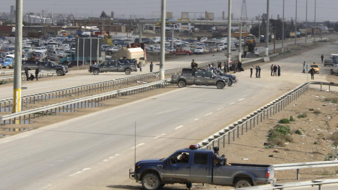 Security forces close the city of Fallujah during a protest, 40 miles (65 kilometers) west of Baghdad, Iraq, Friday, Feb. 1, 2013. Tens of thousands of Sunni protesters blocked a major highway in western Iraq on Friday, as an al-Qaida-affiliated group called on Sunnis to take up arms against the Shiite-led government. (AP Photo/ Khalid Mohammed)