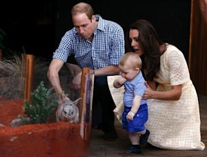 Catherine, the Duchess of Cambridge (R), and her husband…