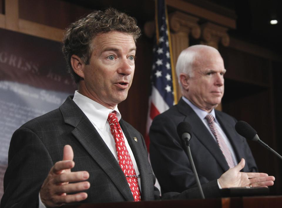 Sen. Rand Paul, R-Ky., left, accompanied by Sen. John McCain, R-Ariz., gestures during a news conference on Capitol Hill in Washington Thursday Oct. 13, 2011, to discuss the introduction of a Republican alternative jobs bill.  (AP Photo/Manuel Balce Ceneta)