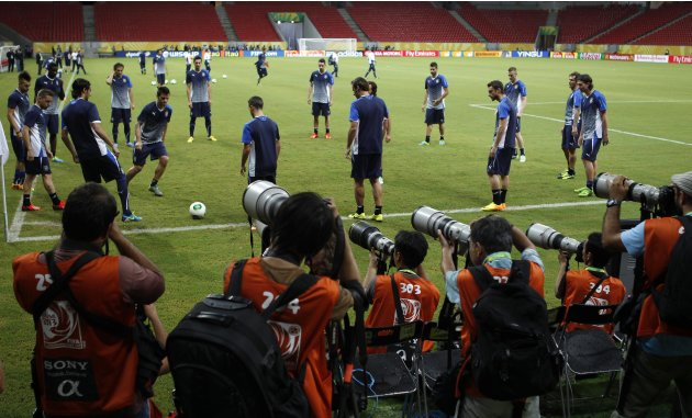 Photographers take pictures of Italy's players during a training session ahead of their Confederations Cup soccer match against Japan in Recife