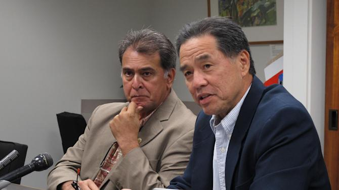 Hawaii state Sen. Clayton Hee, right, and Senate Majority Leader Brickwood Galuteria speak to reporters at the Hawaii Capitol in Honolulu on Saturday, Nov. 9, 2013. Hee said he expects a gay marriage bill to be quickly passed in the Senate with no changes after it received approval from the House. (AP Photo/Oskar Garcia)