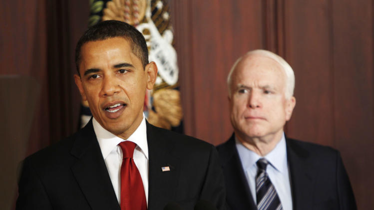 FILE - In this March 4, 2009 file photo, Sen. John McCain, R-Ariz., looks on as President Barack Obama makes remarks on government contracts reform in the Eisenhower Executive Office Building on the White House campus in Washington. In a case of strange bedfellows in American politics, Obama and his re-election advisers are waxing nostalgic for the man the president defeated last time around. They're embracing McCain as a reasonable voice on climate change and immigration, someone who took on extremism in his own party. (AP Photo/Gerald Herbert, File)