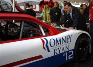 Republican presidential candidate and former Massachusetts Governor Mitt Romney autographs a race car at the Federated Auto Parts 400 NASCAR Sprint Cup Series race in Richmond, Virginia September 8, 2012. REUTERS/Brian Snyder