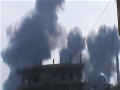Raw: Shells Fall in Homs, Syria, People Scramble