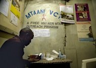 A man waits for his results after being tested for HIV/AIDS at a government run Voluntary Counselling and Testing Center (VCT) in Nairobi's Kibera slum. A cure for AIDS remains a distant prospect but a host of drug treatments and other advances have fueled fresh hope that new human immunodeficiency virus infections may some day be halted for good