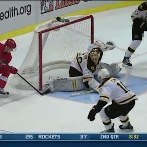 Tomas Tatar dekes around Boston Bruins