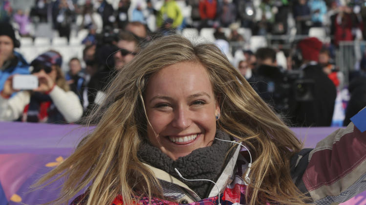 Jamie Anderson of the United States celebrates after winning the women's snowboard slopestyle final at the 2014 Winter Olympics, Sunday, Feb. 9, 2014, in Krasnaya Polyana, Russia. (AP Photo/Sergei Grits)
