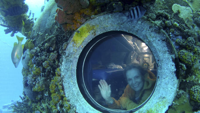 In this undated photo released by One World One Ocean, Sylvia Earle looks out of a porthole from Aquarius, the undersea research laboratory in the Florida Keys. Aquarius is part of NOAA's National Undersea Research Program, but the budget has been cut by the federal government. (AP Photo/One World One Ocean, Mark Ostrick)