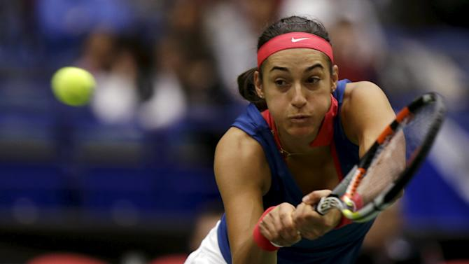 France's Caroline Garcia returns a ball to Czech Republic's Lucie Safarova during their semi-final match of the Fed Cup tennis tournament in Ostrava