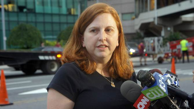 Sharon Ruddock, the aunt of Sarah Murnaghan, talks to reporters outside the Children's Hospital of Philadelphia after the 10-year-old underwent a six-hour double-lung transplant as a result of her severe cystic fibrosis, Wednesday, June 12, 2013. Ruddock said her niece never would have received the transplant without a judge's ruling that made her eligible for adult donor lungs. (AP Photo/Keith Collins)