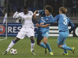 Zenit St Petersburg's Cristian Ansaldi and Axel Witsel fight for the ball with Porto's Jackson Martinez during their Champions League soccer match at the Petrovsky stadium in St. Petersburg