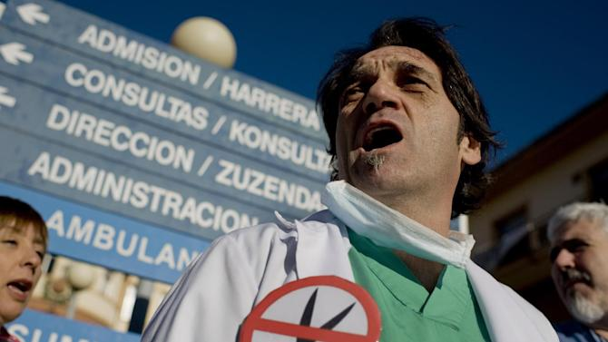 Health workers protest against the austerity measures, outside a hospital in Pamplona, northern Spain, on Tuesday, Jan. 8, 2013. Spain Treasury says it plans to borrow some euro 230 billion ($300 billion) in 2013, down from euro 250 billion last year, and expects a more relaxed year in interest rates compared to 2012 when it came close to seeking a sovereign bailout. (AP Photo/Alvaro Barrientos)