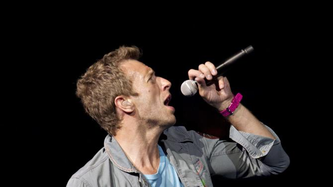 FILE - This April 17, 2012 file photo shows Chris Martin, lead singer of Coldplay, performing in Edmonton, Alberta, Canada. Coldplay and Eric Clapton have been added to the lineup for the 12-12-12 Hurricane Sandy benefit concert. It will be broadcast across 34 U.S. and international television, radio and Internet across six continents. Producers said Monday, Dec. 3, the concert will be available to 1 billion people across six continents. (AP Photo/The Canadian Press,Jason Franson)