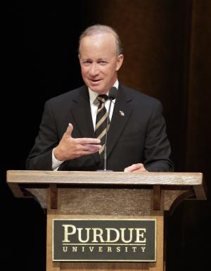 FILE - In this Thursday, June 21, 2012 file photo, former Indiana Gov. Mitch Daniels speaks after being named as the next president of Purdue University by the school's trustees in West Lafayette, Ind. Daniels pledged to promote academic freedom, not stifle it, when he became president at Purdue in January amid questions about his appointment and academic credentials. But emails obtained by The Associated Press show Daniels went out of his way during his second term as governor to destroy what he considered liberal breeding grounds at Indiana's public universities. (AP Photo/Michael Conroy, File)