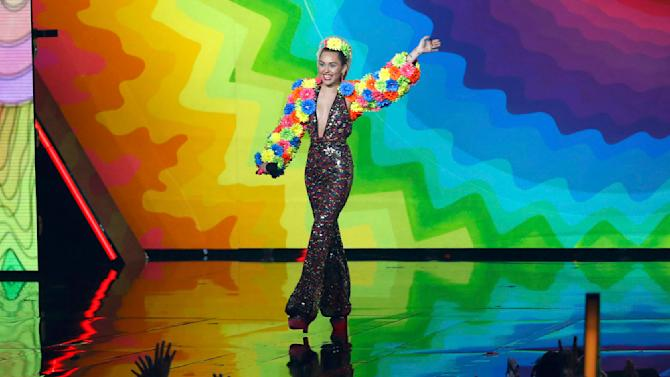 Show host Miley Cyrus takes the stage at the 2015 MTV Video Music Awards in Los Angeles
