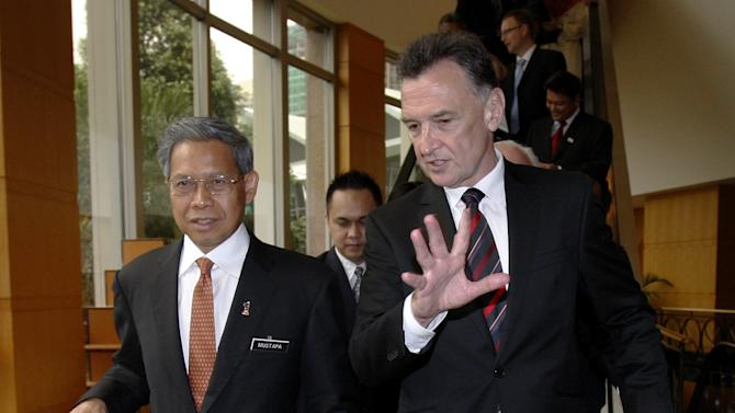 Australian Trade Minister Craig Emerson, right, talks to his Malaysian counterpart Mustapa Mohamed as they arrive for the signing of the Malaysia-Australia Free Trade Agreement in Kuala Lumpur, Malaysia, Tuesday, May 22, 2012. (AP Photo/Lai Seng Sin)