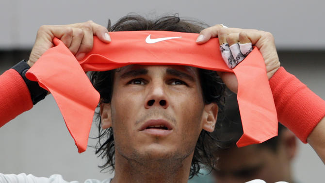 Spain's Rafael Nadal wears his head band during a pause of his match with Latvia's Ernests Gulbis at the Italian Open tennis tournament in Rome, Thursday, May 16, 2013. (AP Photo/Andrew Medichini)
