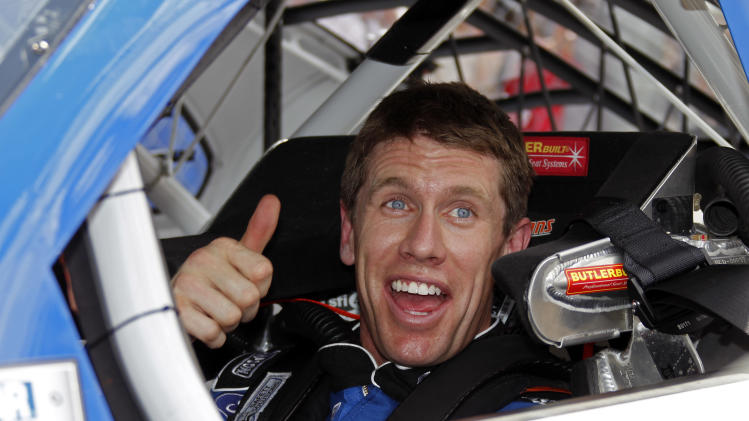 Carl Edwards gives a thumbs-up in his car after his qualifying run for the NASCAR Daytona 500 auto race at Daytona International Speedway, Sunday, Feb. 19, 2012, in Daytona Beach, Fla. Edwards won the pole (AP Photo/Terry Renna)