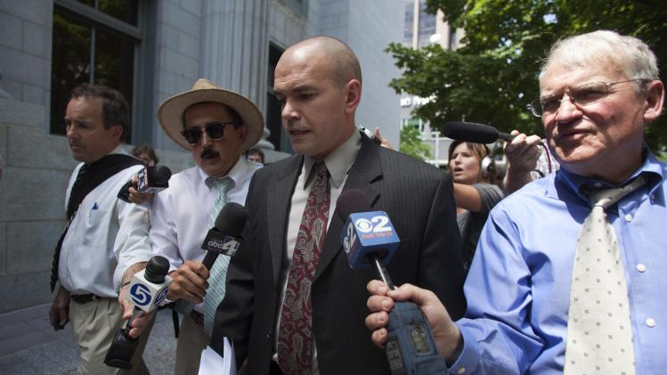 Environmental activist Tim DeChristopher is surrounded by media as he arrives to the Frank E. Moss Federal Courthouse in Salt Lake City, Tuesday, July 26, 2011. DeChristopher is scheduled to be sentenced on federal charges for bidding up prices at an auction of land leases that he couldn't pay for. (AP Photo/Jim Urquhart)