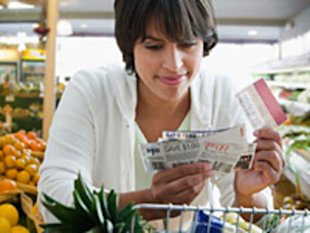 Consumers redeemed 63 percent more coupons in 2011 as they increasingly looked online and used their smartphones to scour for deals, according to Coupons.org.