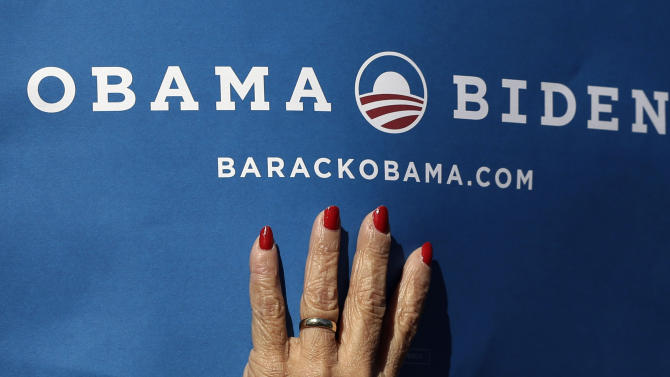 A supporter holds a sign for President Barack Obama and Vice President Joe Biden at Centre College in Danville, Ky., site of the vice presidential debate, Thursday, Oct. 11, 2012. Biden will face Republican vice presidential candidate, Rep. Paul Ryan, R-Wis., Thursday. (AP Photo/Eric Gay)
