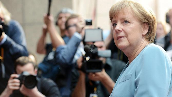 German Chancellor Angela Merkel arrives for an EU summit at the EU Council in Brussels, Wednesday, May 23, 2012.  The leaders of the 27 countries that make up the European Union are to meet in Brussels Wednesday to try and find a way to keep the debt crisis in Europe from spiraling out of control and promote jobs and growth. (AP Photo/Geert Vanden Wijngaert)