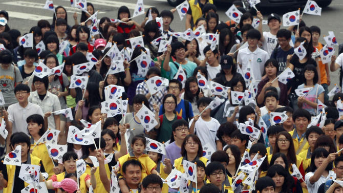 South Koreans wave their national flags to celebrate the Liberation Day from Japanese colonial rule in 1945, in Seoul, South Korea, Monday, Aug. 15, 2011. (AP Photo/Lee Jin-man)
