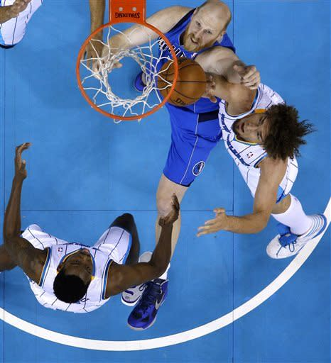 Marion leads Mavs to 107-89 win over Hornets